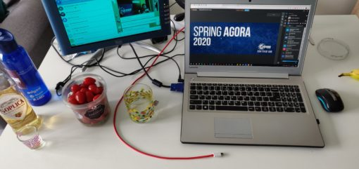 image of a laptop showing the Spring Agora 2020 platform