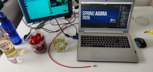 image of a laptop showing the Spring Agora 2020 platform