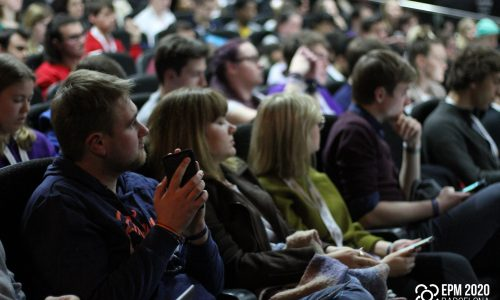 AEGEE members sitting in a lecture hall listening attentively
